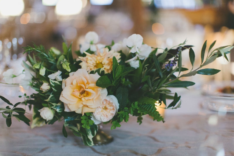 Foraged garden style centerpiece showcasing amazing garden roses. Flowers by Seascape Flowers. Coordinated by Coastside Couture. Photography by Two Foxes Photography. Location at the Santa Lucia Preserve.
