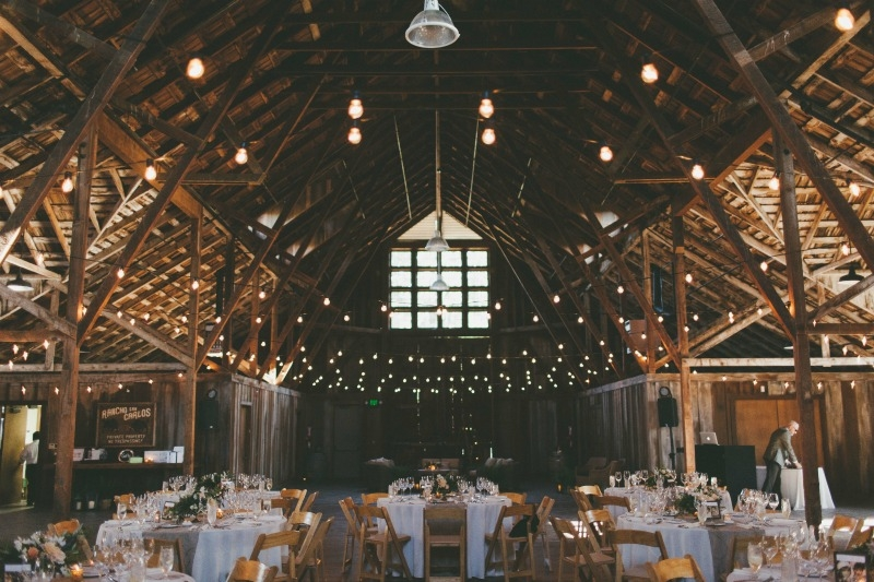 Sophisticated reception in the barn at the Santa Lucia Preserve.  Flowers by Seascape Flowers. Coordinated by Coastside Couture. Photography by Two Foxes Photography. Location at the Santa Lucia Preserve.