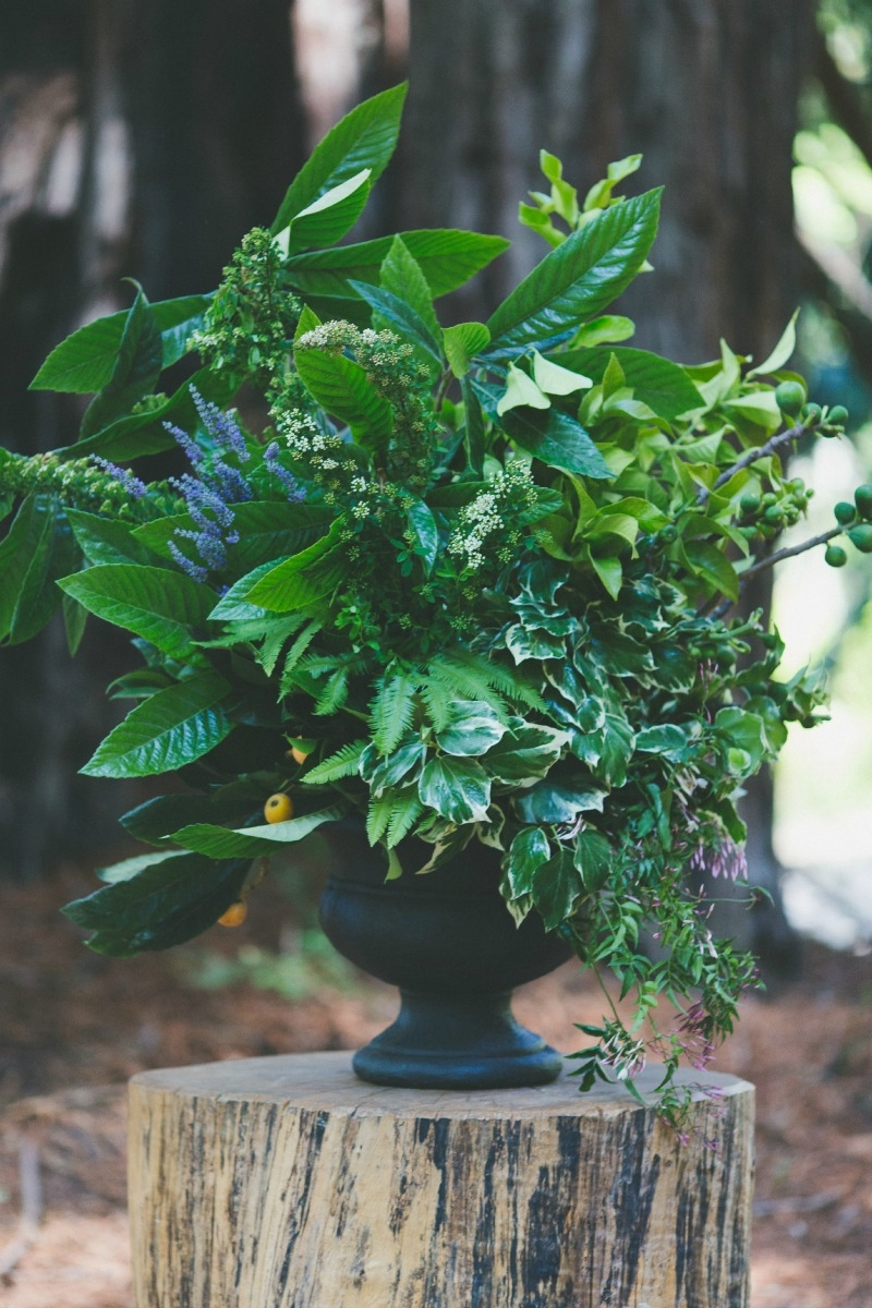 Beautiful foraged garden urns were a dramatic statement in the redwood grove at the Santa Lucia Preserve. Flowers by Seascape Flowers. Coordinated by Coastside Couture. Photography by Two Foxes Photography.  Location at the Santa Lucia Preserve