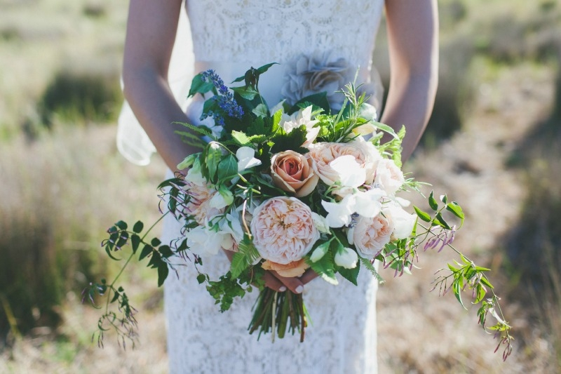 Stunning bridal bouquet of garden roses and foraged greenery. Flowers by Seascape Flowers. Coordinated by Coastside Couture. Photography by Two Foxes Photography.  Location at the Santa Lucia Preserve.