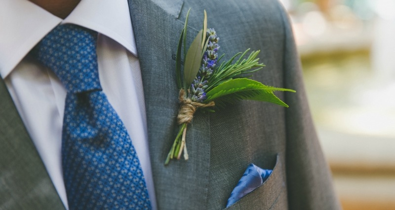 The grooms boutonniere was a casual cluster of lavender, camellia, fern, olive and rosemary tied off with twine. Flowers by Seascape Flowers. Coordinated by Coastside Couture. Photography by Two Foxes Photography. Location at the Santa Lucia Preserve