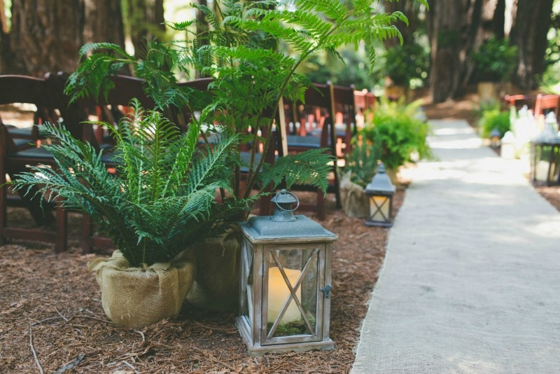 Glowing lanterns and ferns made for a romantic and rustic ceremony. Flowers by Seascape Flowers. Coordinated by Coastside Couture. Photography by Two Foxes Photography.  Location at the Santa Lucia Preserve