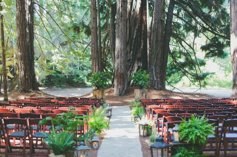 The ceremony is set in the redwood grove at the Santa Lucia Preserve. Flowers by Seascape Flowers. Coordinated by Coastside Couture. Photography by Two Foxes Photography. Location at the Santa Lucia Preserve
