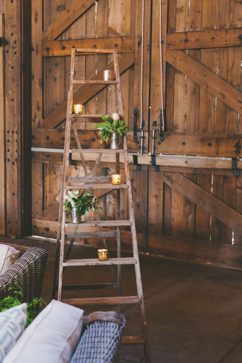 A rustic ladder decked out with mercury glass votives and mini arrangements finishes off this sweet lounge space. Flowers by Seascape Flowers. Coordinated by Coastside Couture. Photography by Two Foxes Photography. Location at the Santa Lucia Preserv