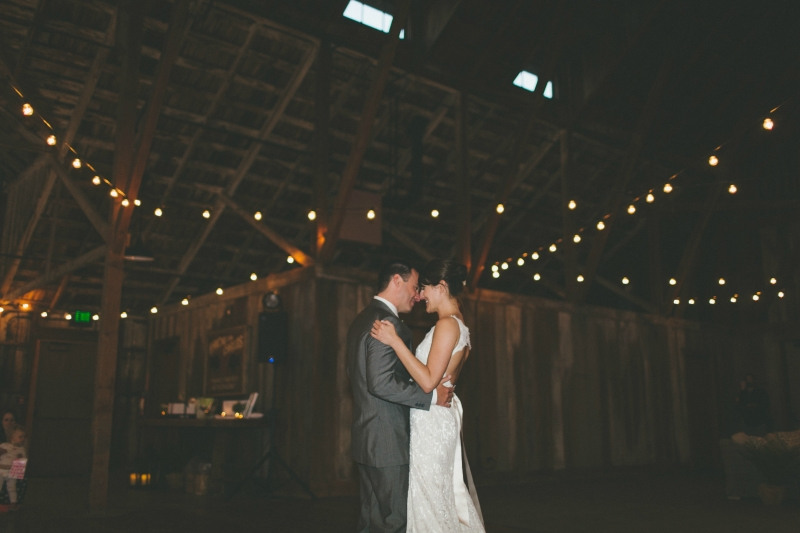 The bride and groom share their first dance. Flowers by Seascape Flowers. Coordinated by Coastside Couture. Photography by Two Foxes Photography. Location at the Santa Lucia Preserve.