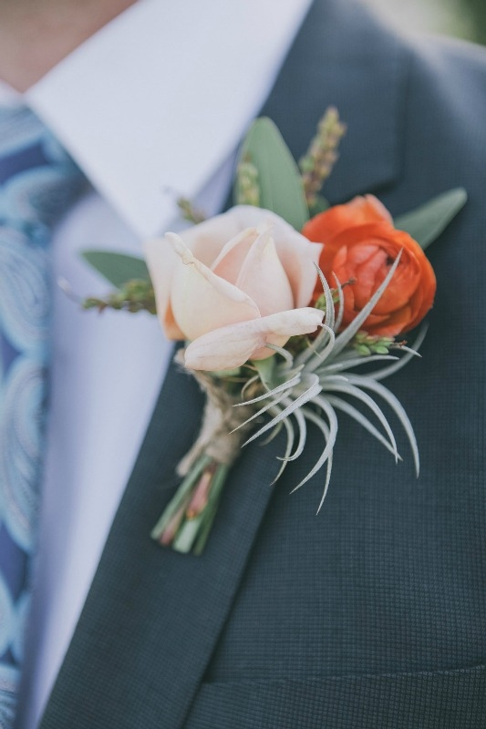 In love with all of the textures in this boutonniere!!! Garden roses, air plants, and ranunculus to name a few of the elements.