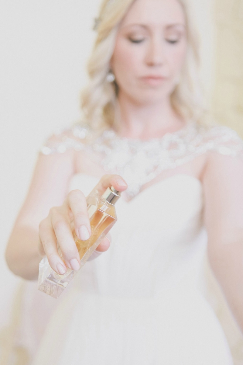 Our stunning bride giving herself a little pre wedding spritz!