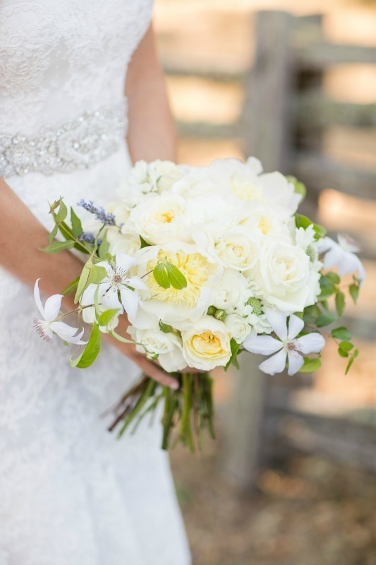 This bouquet has all the goods! Peonies, clematis and garden roses to name a few of the blooms that helped make this bouquet so breathtaking!  Dreamy wedding at the Santa Lucia Preserve. Photography by Larissa Cleveland Photography. Coordination by C