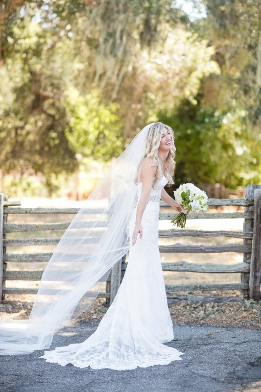 Our stunning bride! Dreamy wedding at the Santa Lucia Preserve. Photography by Larissa Cleveland Photography. Coordination by Coastside Couture. Flowers by Seascape Flowers. Photo Booth provided by the Booth