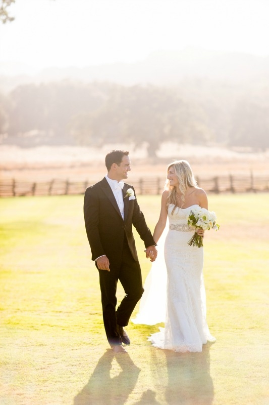 Dreamy wedding at the Santa Lucia Preserve. Photography by Larissa Cleveland Photography. Coordination by Coastside Couture. Flowers by Seascape Flowers. Photo Booth provided by the Booth
