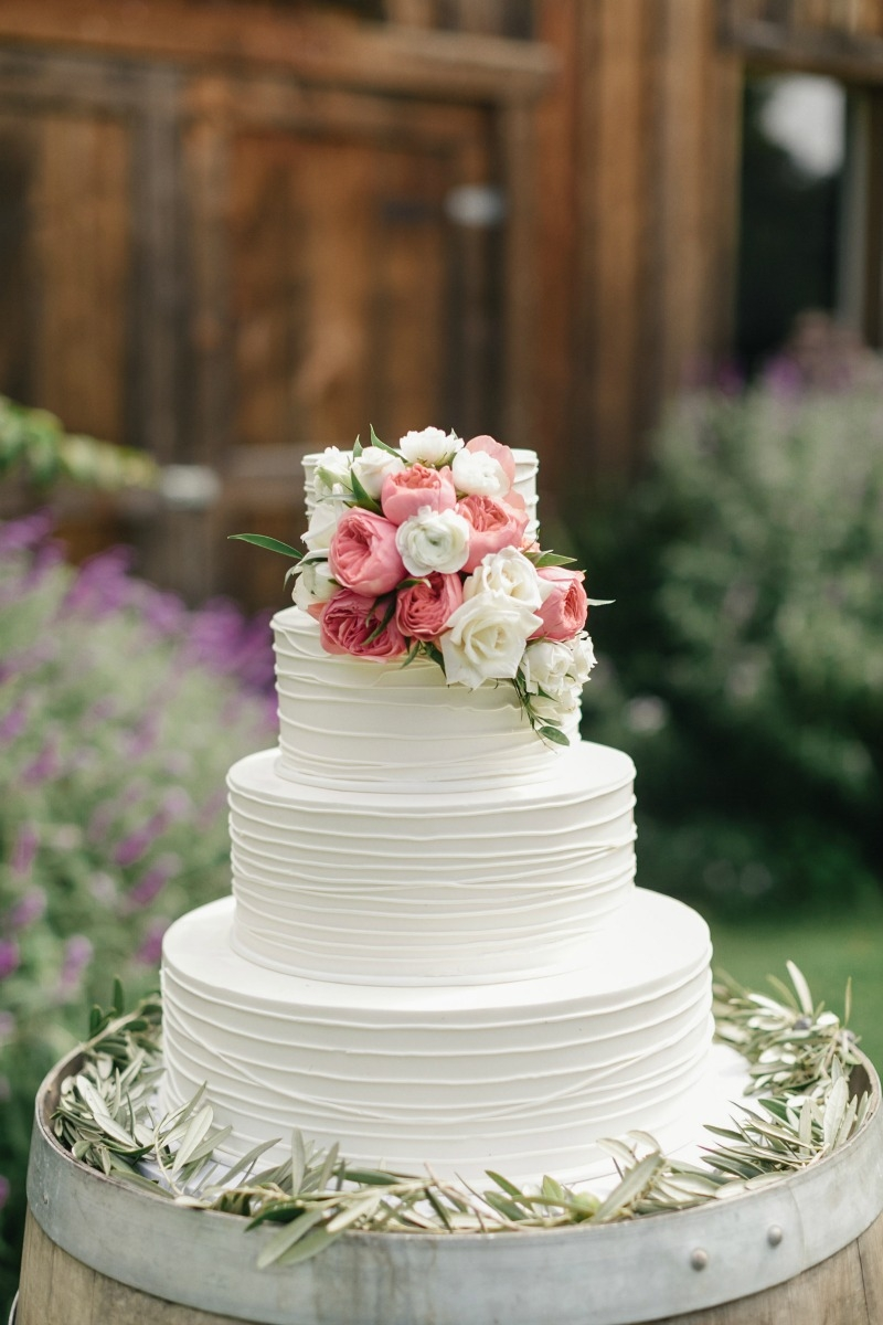 All you need is love... and cake! Beautiful wedding at Rancho Soquel. Flowers by Seascape Flowers. Photography by Jana Williams Photography. Coordination by The Wedding Connection. Cake by The Buttery.