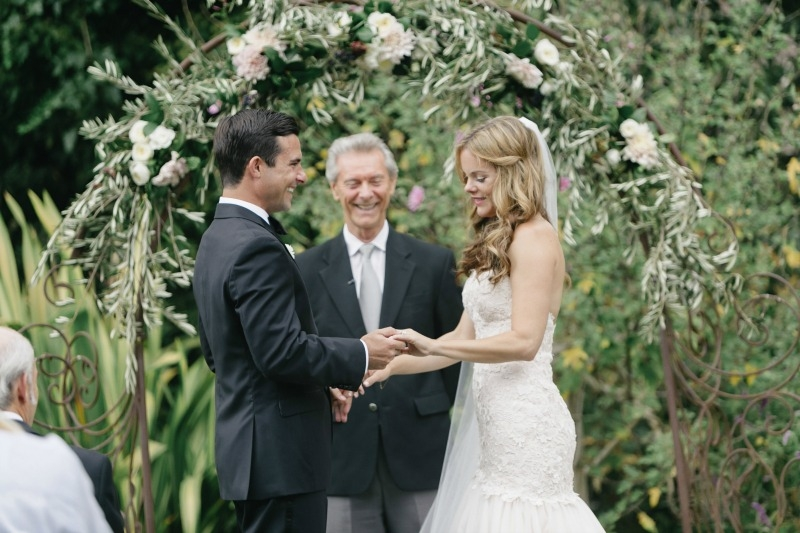 The bride and groom exchanging their vows. Beautiful wedding at Rancho Soquel. Flowers by Seascape Flowers. Photography by Jana Williams Photography. Coordination by The Wedding Connection. Cake by The Buttery.