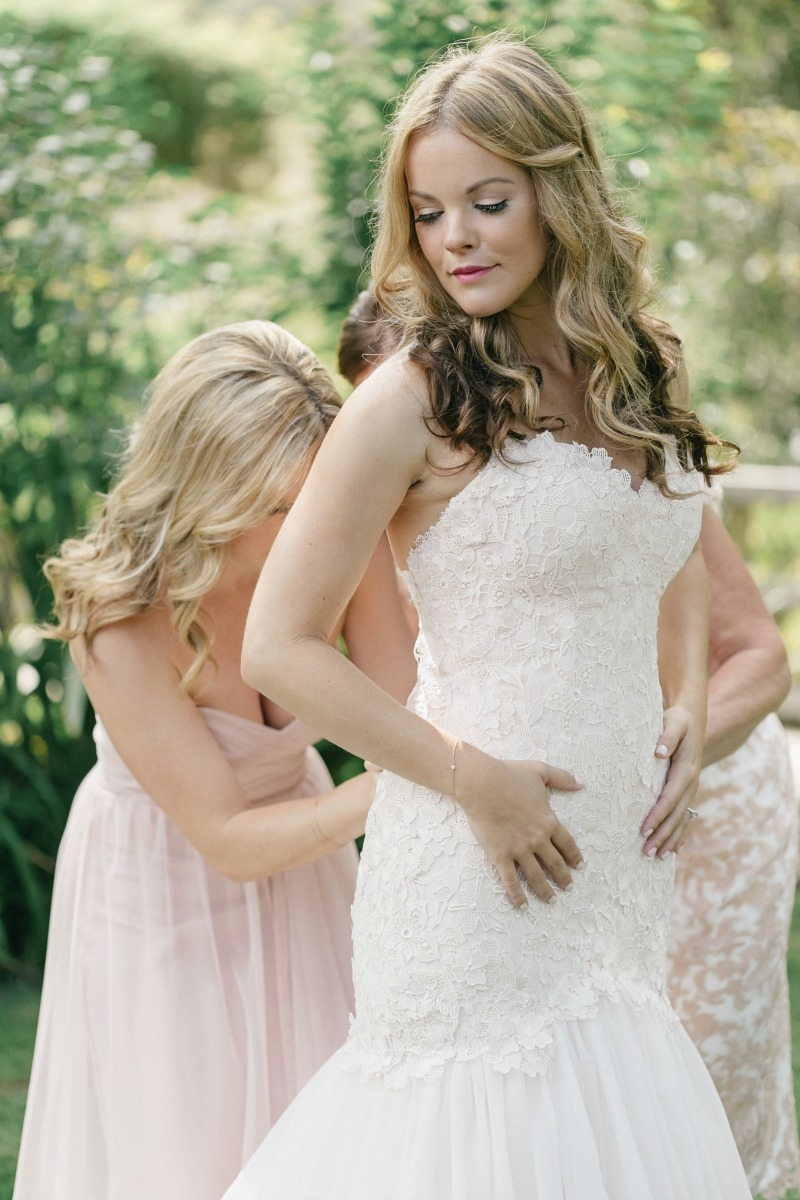 The beautiful bride getting zipped up by her sis. Beautiful wedding at Rancho Soquel. Flowers by Seascape Flowers. Photography by Jana Williams Photography. Coordination by The Wedding Connection. Cake by The Buttery.