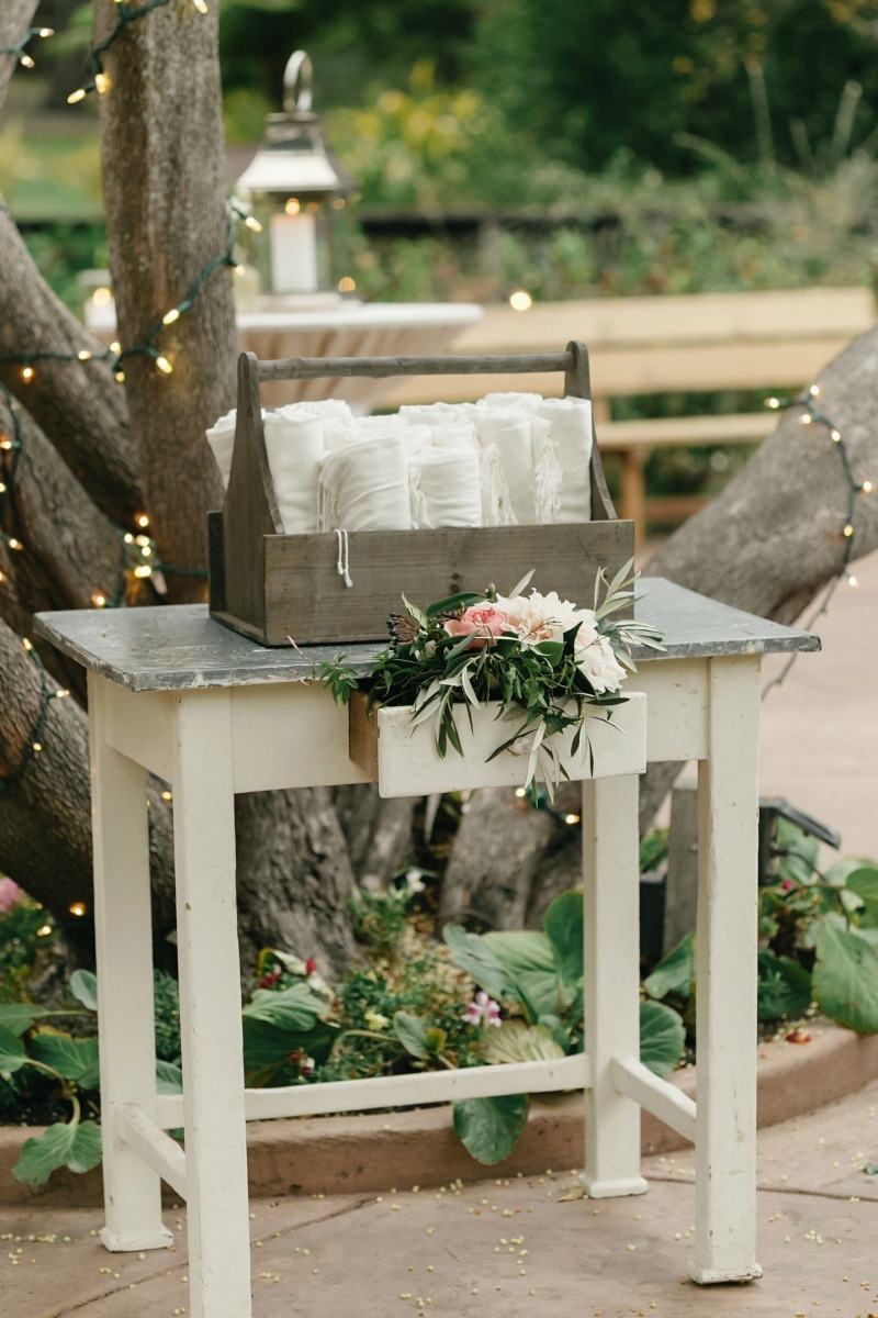 Our zinc top table and wooden tool box help show off these pretty pashminas.   Beautiful wedding at Rancho Soquel. Flowers by Seascape Flowers. Photography by Jana Williams Photography. Coordination by The Wedding Connection. Cake by The Buttery.