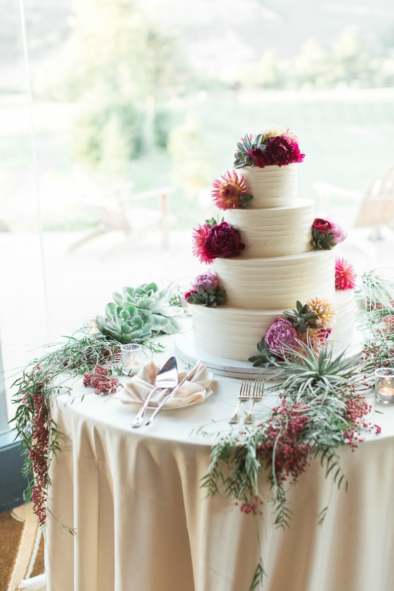 Vibrant watercolor wedding at Carmel Valley Ranch photographed Carlie Statsky Photography. Cake by The Buttery. Coordination by Coastside Couture. MUAH by The Hair & Make Up Co. Flowers by Seascape Flowers.
