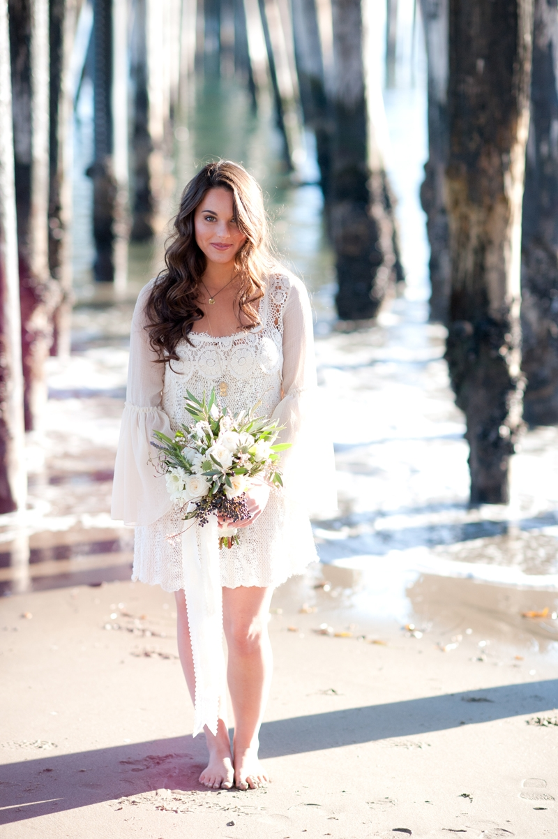 Our beautiful bride. Flowers and design by Seascape Flowers. Photographed by Susannah Gill- Photographic Storytelling. Cake by the Buttery. Paper Goods by Brenna Catalano Design Studios.Hair and make up by Megan Smith of Tranquil Spa. Dress from Free