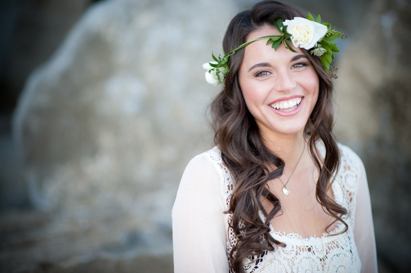 What's not to love about a pretty bride wearing a floral crown??? Flowers and design by Seascape Flowers. Photographed by Susannah Gill- Photographic Storytelling. Cake by the Buttery. Paper Goods by Brenna Catalano Design Studios.Hair and make
