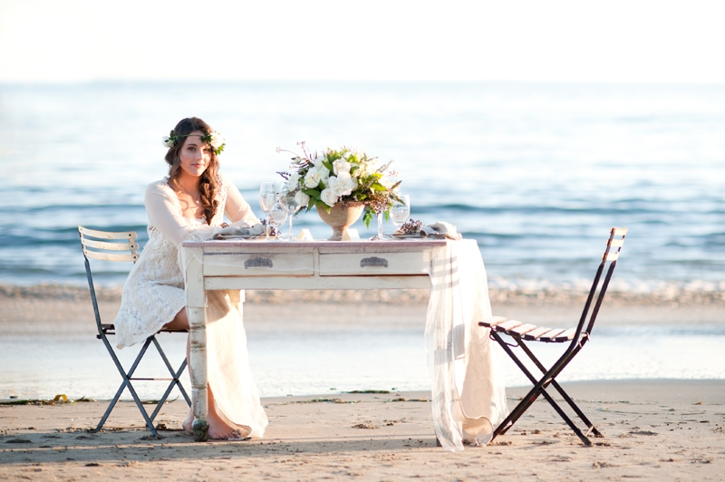 Dinner set for two. Flowers and design by Seascape Flowers. Photographed by Susannah Gill- Photographic Storytelling. Cake by the Buttery. Paper Goods by Brenna Catalano Design Studios.Hair and make up by Megan Smith of Tranquil Spa. Dress from Free