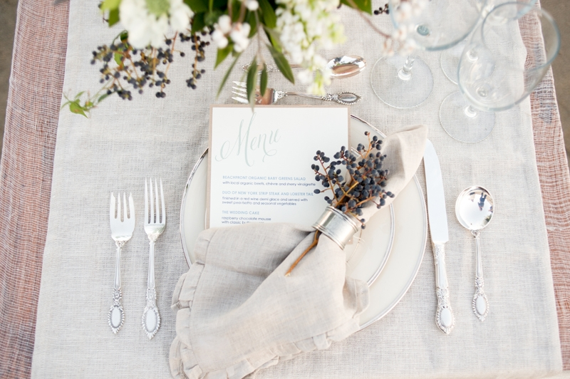 Flowers and design by Seascape Flowers. Photographed by Susannah Gill- Photographic Storytelling. Cake by the Buttery. Paper Goods by Brenna Catalano Design Studios.Hair and make up by Megan Smith of Tranquil Spa. Dress from Free People. Jewelry by A