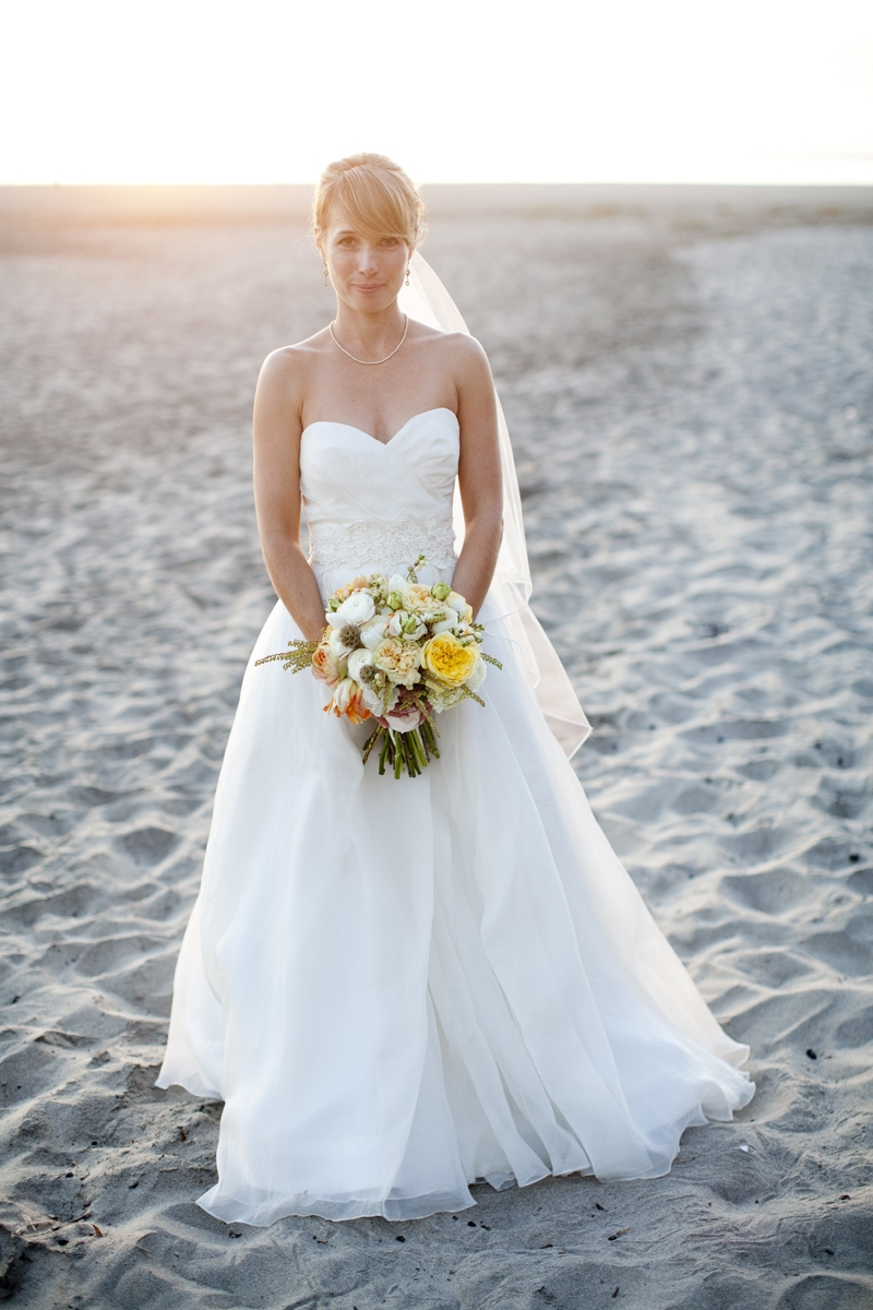 The beautiful bride on the beach. Flowers and Decor by Seascape Flowers. Photography by  Evynn Levalley Photography. Linens by La Tavola Linens. Venue at Seascape Beach Resort.