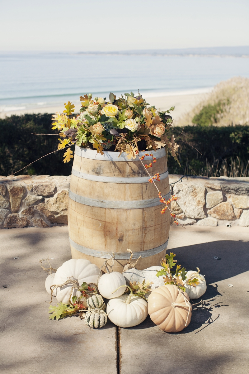 This rustic wine barrel was staged for the wedding ceremony. Flowers and Decor by Seascape Flowers. Photography by  Evynn Levalley Photography. Linens by La Tavola Linens. Venue at Seascape Beach Resort.