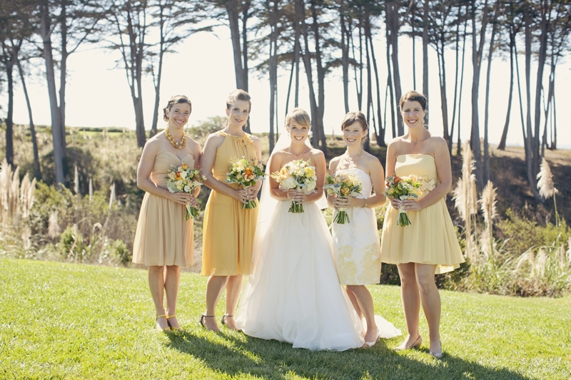 The bride and her maids pose along the bluff at the Seascape Beach Resort. Flowers and Decor by Seascape Flowers. Photography by  Evynn Levalley Photography. Linens by La Tavola Linens. Venue at Seascape Beach Resort.