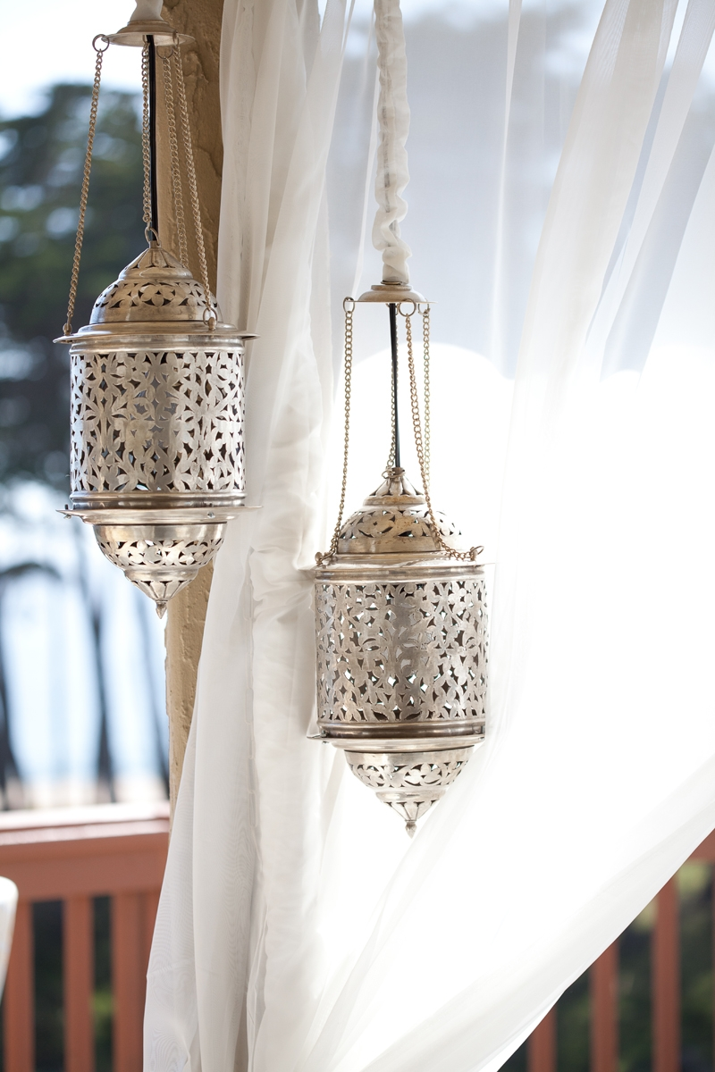 These vintage Moroccan lanterns make for a cool outdoor lounge! Flowers and decor by Seascape Flowers. Photographed by Danielle Gillet Photography. Linens by La Tavola Linens. Venue at Seascape Beach Resort.