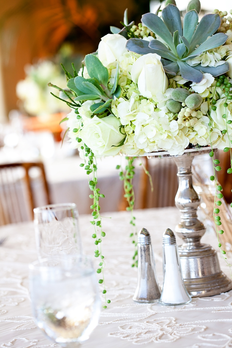 Succulent, garden roses, and hydrangea centerpieces. Flowers and decor by Seascape Flowers. Photographed by Danielle Gillet Photography. Linens by La Tavola Linens. Venue at Seascape Beach Resort.