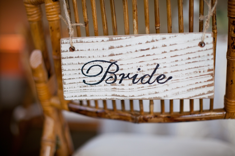 Vintage white wash bride sign by seascape flowers. Flowers and decor by Seascape Flowers. Photographed by Danielle Gillet Photography. Linens by La Tavola Linens. Venue at Seascape Beach Resort.