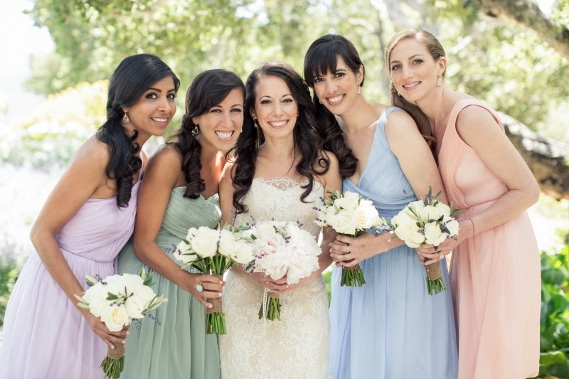 The beautiful bride and her maids posing with their bouquets. Casual Holman Ranch Wedding. Flowers by Seascape Flowers. Coordinated by Coastside Couture. Photograhed by Carlie Statsky Photography. Paper Goods by Crescent Moon Paper. Catered by Paradi