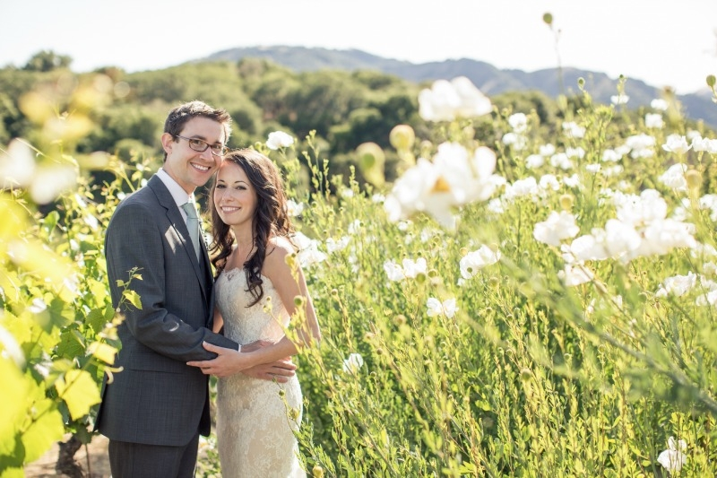 The cute couple after their nuptials. Casual Holman Ranch Wedding. Flowers by Seascape Flowers. Coordinated by Coastside Couture. Photograhed by Carlie Statsky Photography. Paper Goods by Crescent Moon Paper. Catered by Paradise Catering. MUA Shawn C