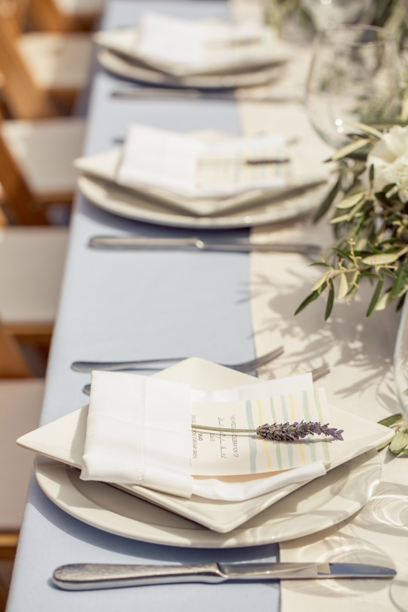 These simple place settings were finished off with sprigs of lavender. Casual Holman Ranch Wedding. Flowers by Seascape Flowers. Coordinated by Coastside Couture. Photograhed by Carlie Statsky Photography. Paper Goods by Crescent Moon Paper. Catered