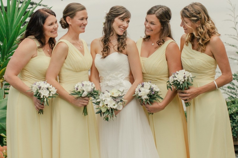 The bridal party flowers. Flower by Seascape Flowers. Coordinated by Coastside Couture. Photographed by Carlie Stasky Photography. Catering by A Taste of Elegance. Rentals from Classic Rentals. Tent from Chic Rentals. Hair by Melissa Marie Hair. Make