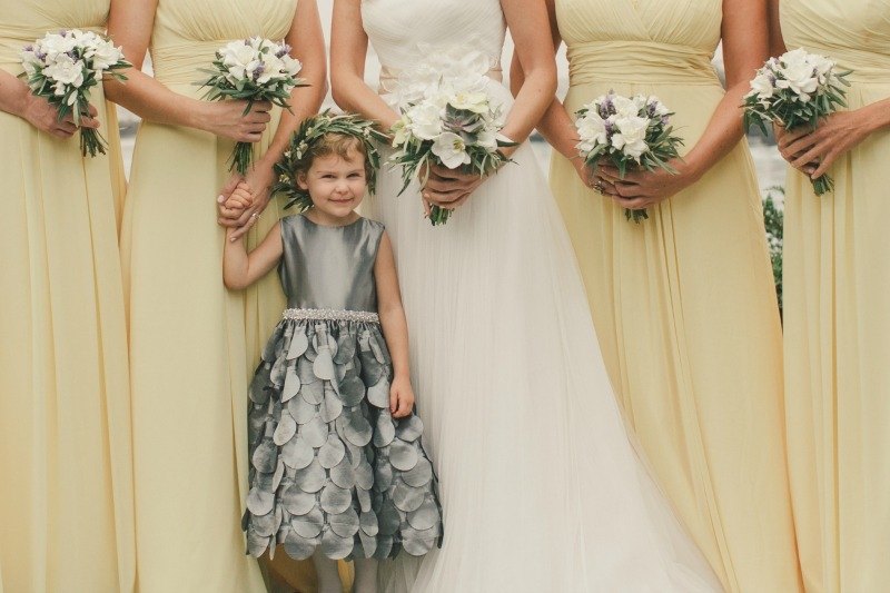 This cutie of a flower girl nestled between the bridesmaids. Flower by Seascape Flowers. Coordinated by Coastside Couture. Photographed by Carlie Stasky Photography. Catering by A Taste of Elegance. Rentals from Classic Rentals. Tent from Chic Rental