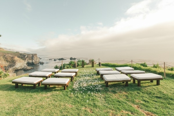 This cliff side ceremony is breathtaking! Flower by Seascape Flowers. Coordinated by Coastside Couture. Photographed by Carlie Stasky Photography. Catering by A Taste of Elegance. Rentals from Classic Rentals. Tent from Chic Rentals. Hair by Melissa