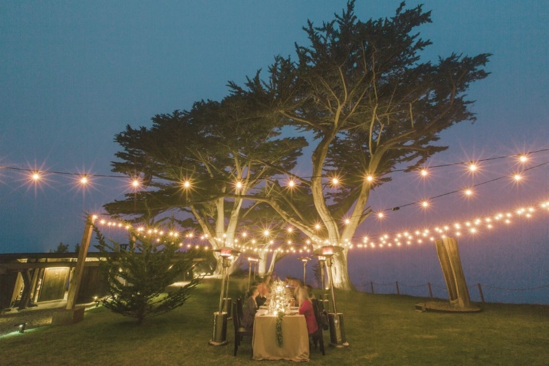 The cliff side reception at Anderson Canyon. Flower by Seascape Flowers. Coordinated by Coastside Couture. Photographed by Carlie Stasky Photography. Catering by A Taste of Elegance. Rentals from Classic Rentals. Tent from Chic Rentals. Hair by Melis