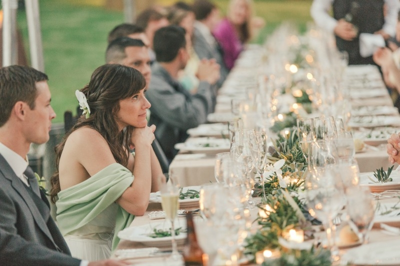 The wedding reception at anderson canyon. Flower by Seascape Flowers. Coordinated by Coastside Couture. Photographed by Carlie Stasky Photography. Catering by A Taste of Elegance. Rentals from Classic Rentals. Tent from Chic Rentals. Hair by Melissa
