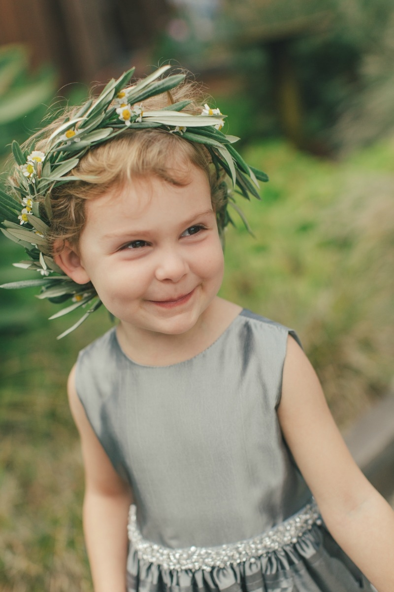 The cute flower girl in an olive and fever few head wreath. Flower by Seascape Flowers. Coordinated by Coastside Couture. Photographed by Carlie Stasky Photography. Catering by A Taste of Elegance. Rentals from Classic Rentals. Tent from Chic Rentals