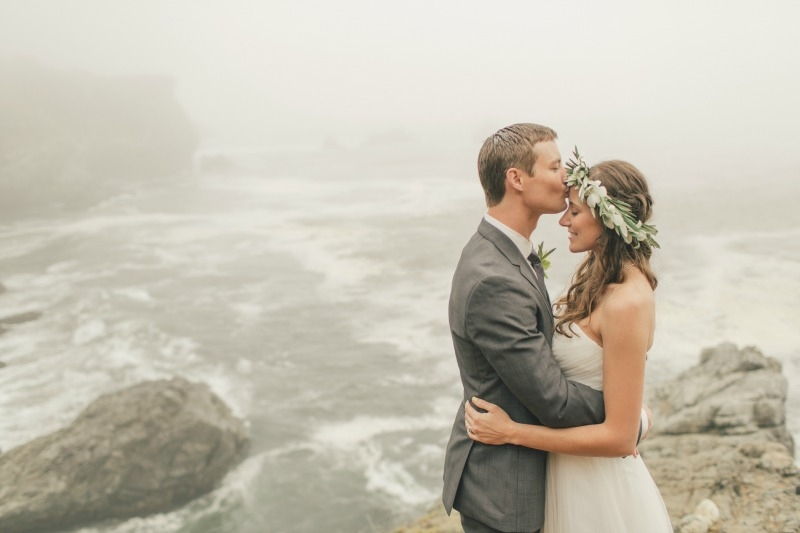 Post nuptials on the foggy cliff of Anderson Canyon. Flower by Seascape Flowers. Coordinated by Coastside Couture. Photographed by Carlie Stasky Photography. Catering by A Taste of Elegance. Rentals from Classic Rentals. Tent from Chic Rentals. Hair
