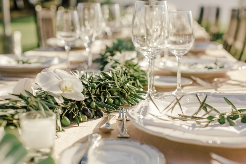 In love with how simple and sophisticated these  olive garland and succulent centerpieces are. Flower by Seascape Flowers. Coordinated by Coastside Couture. Photographed by Carlie Stasky Photography. Catering by A Taste of Elegance. Rentals from Clas