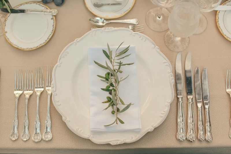 Sprigs of fruiting olive for the place settings. Flower by Seascape Flowers. Coordinated by Coastside Couture. Photographed by Carlie Stasky Photography. Catering by A Taste of Elegance. Rentals from Classic Rentals. Tent from Chic Rentals. Hair by M