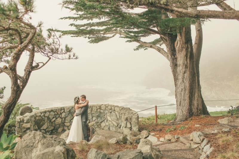 The bride and groom on the foggy cliffs of Anderson Canyon. Flower by Seascape Flowers. Coordinated by Coastside Couture. Photographed by Carlie Stasky Photography. Catering by A Taste of Elegance. Rentals from Classic Rentals. Tent from Chic Rentals