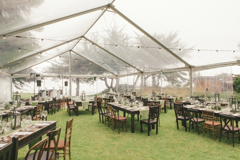 Dreamy tented wedding reception. Flower by Seascape Flowers. Coordinated by Coastside Couture. Photographed by Carlie Stasky Photography. Catering by A Taste of Elegance. Rentals from Classic Rentals. Tent from Chic Rentals. Hair by Melissa Marie Hai