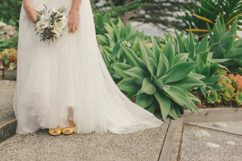 A peak at the brides  adorable yellow heels. Flower by Seascape Flowers. Coordinated by Coastside Couture. Photographed by Carlie Stasky Photography. Catering by A Taste of Elegance. Rentals from Classic Rentals. Tent from Chic Rentals. Hair by Melis