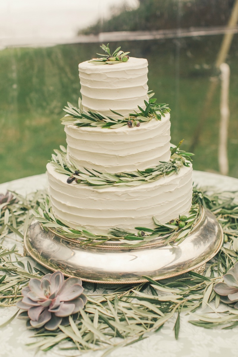 Loving all of this olive on the cake!Flower by Seascape Flowers. Coordinated by Coastside Couture. Photographed by Carlie Stasky Photography. Catering by A Taste of Elegance. Rentals from Classic Rentals. Tent from Chic Rentals. Hair by Melissa Marie