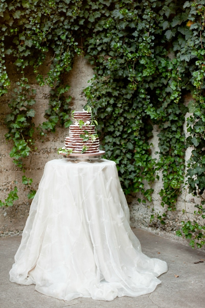 Scrumptious naked cake by the Buttery. Flowers by Seascape Flowers. Photography by Susannah Gill-Photographic Storytelling. Hair and make Up by Blending Beautiful. Dress from Jewels on Pacific Avenue. Cake by The Buttery. Location at Sandrock Farms.