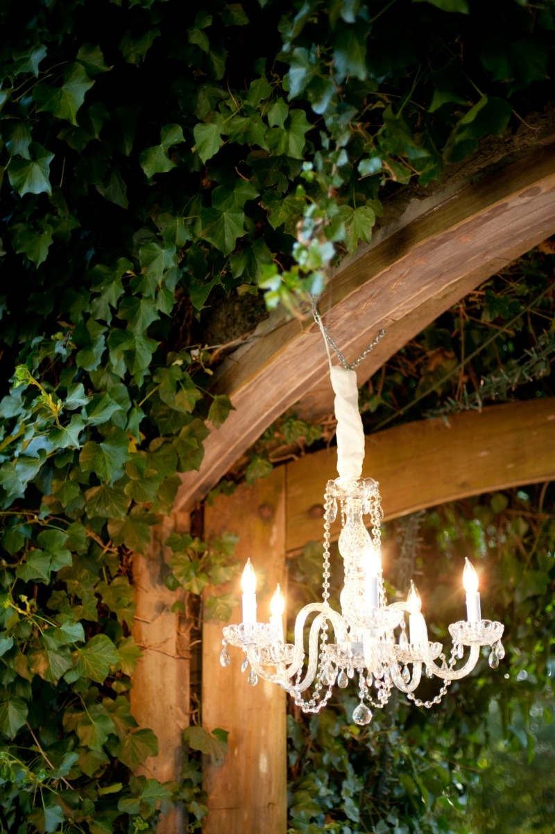 Our small crystal chandelier illuminating the entrance to the wine cellar at Sandrock Farms. Flowers by Seascape Flowers. Photography by Susannah Gill-Photographic Storytelling. Hair and make Up by Blending Beautiful. Dress from Jewels on Pacific Ave