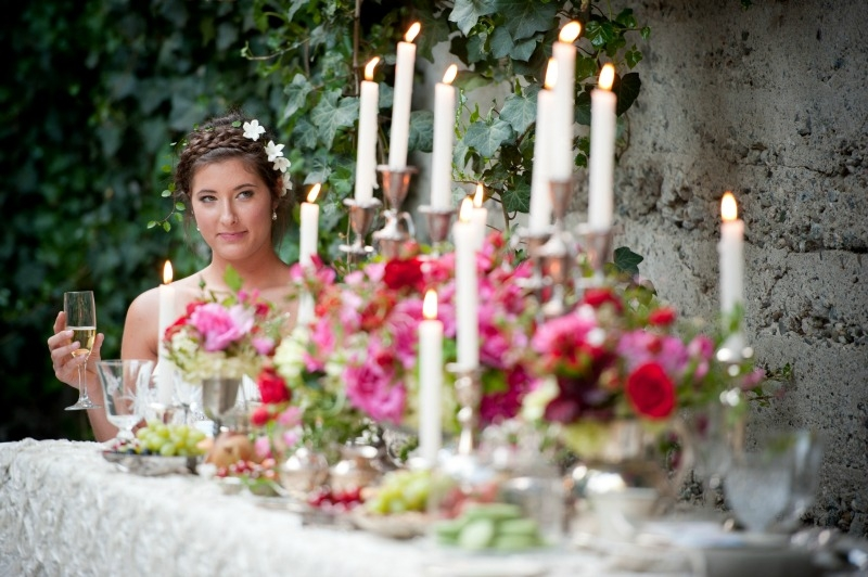 The bride giving a coy smile. Flowers by Seascape Flowers. Photography by Susannah Gill-Photographic Storytelling. Hair and make Up by Blending Beautiful. Dress from Jewels on Pacific Avenue. Cake by The Buttery. Location at Sandrock Farms. Linen by