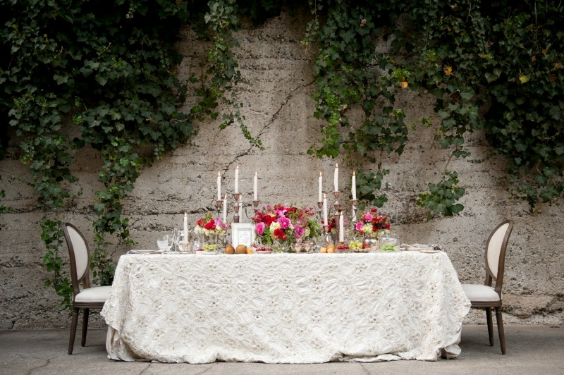 Lush reception table for two! Flowers by Seascape Flowers. Photography by Susannah Gill-Photographic Storytelling. Hair and make Up by Blending Beautiful. Dress from Jewels on Pacific Avenue. Cake by The Buttery. Location at Sandrock Farms. Linen by