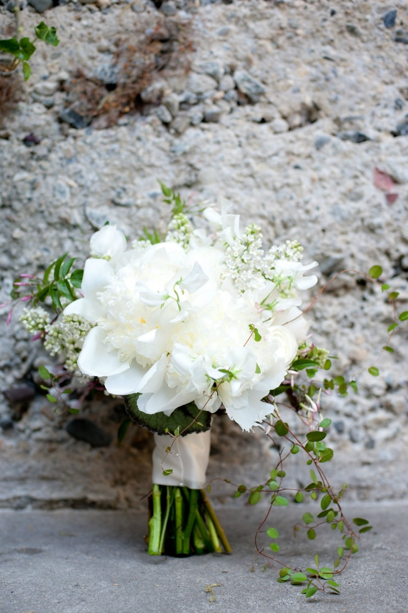 White peony and angle vine make for a dramatic all white bridal bouquet. Flowers by Seascape Flowers. Photography by Susannah Gill-Photographic Storytelling. Hair and make Up by Blending Beautiful. Dress from Jewels on Pacific Avenue. Cake by The But